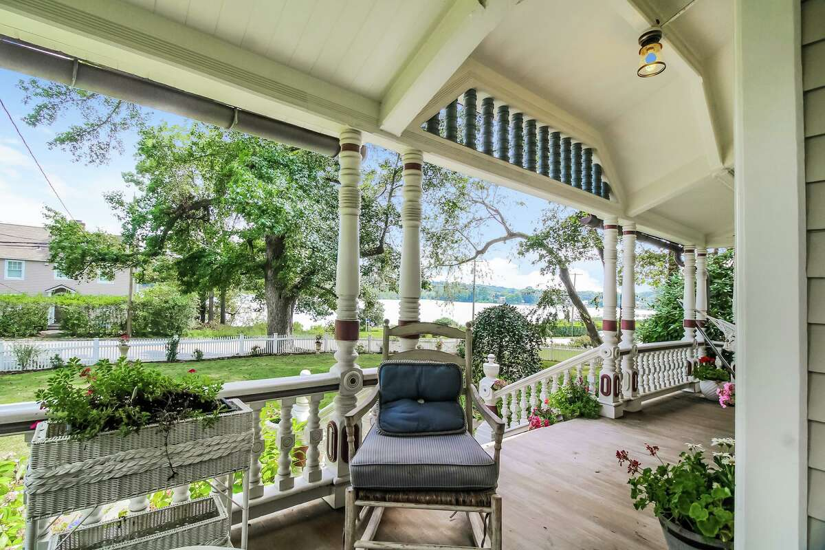 From the front porch and several rooms there are unimpeded views of the Saugatuck River, across the street from this house.