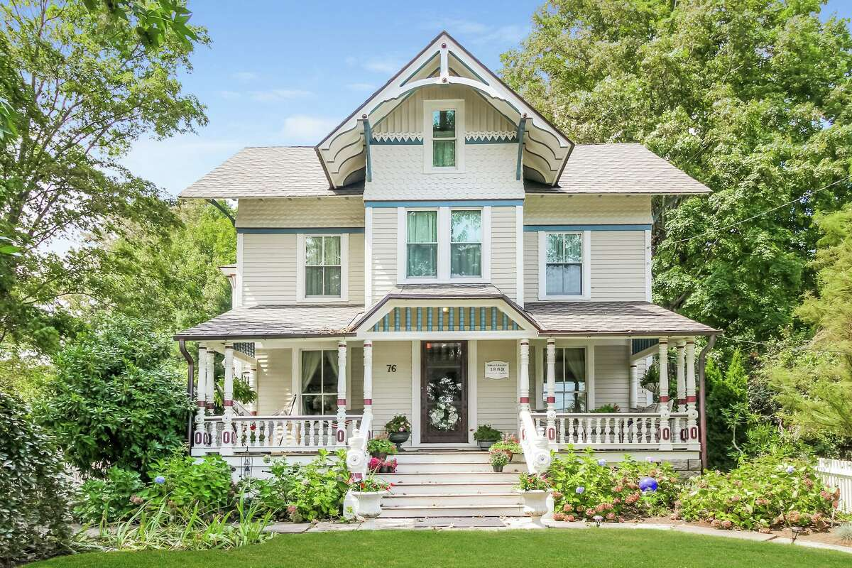 """According to an Oct. 24, 2015 article in the Westport News, in """"early conversations with contractors, the owners realized that although the house had good bones 'all of its vital organs needed a trip to the emergency room.' ... Their goal for the renovation was to keep its historic integrity but also create a functional home with the conveniences required by today's lifestyle."""" It was also featured on the 2015 Westport Historic Society Holiday House Christmas Tour. According to a document from the Historical Society, this is a """"stick-style"""" house, which refers more to its ornate exterior decoration than its architectural style. In the renovation, this nine-room, 4,027-square-foot house, which enjoys attractive and unobstructed views of the Saugatuck River, received a new roof that has a lifetime warranty. All the interior wide-board floors were refinished, the walls and ceilings were re-plastered and painted and the original glass-pane windows were replaced with double-pane windows for energy efficiency. The hand-milled elm wood trim is the original trim and it is evident throughout the house."""