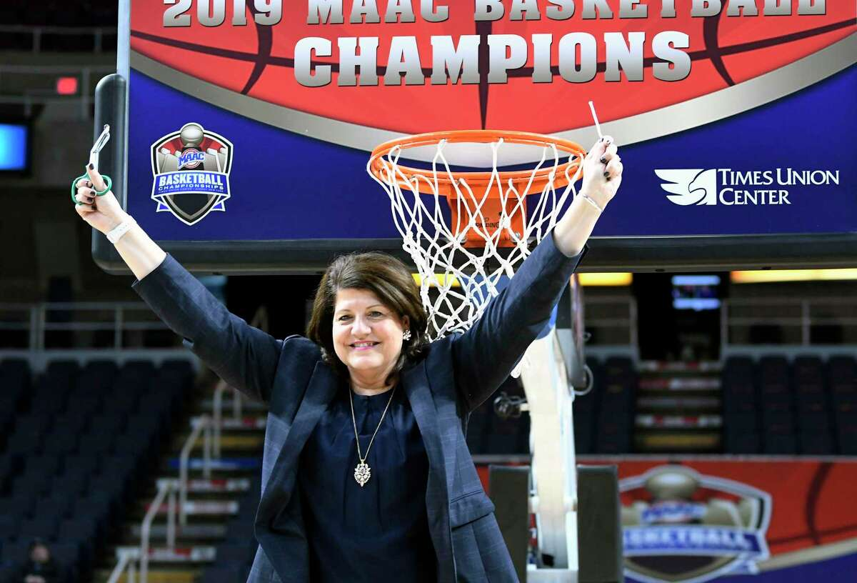 Quinnipiac head coach Tricia Fabbri cuts a section of the net after a 81-51 win against Marist after the NCAA college basketball game in the Metro Atlantic Athletic Conference women's tournament, Monday, March 11, 2019, in Albany, N.Y.