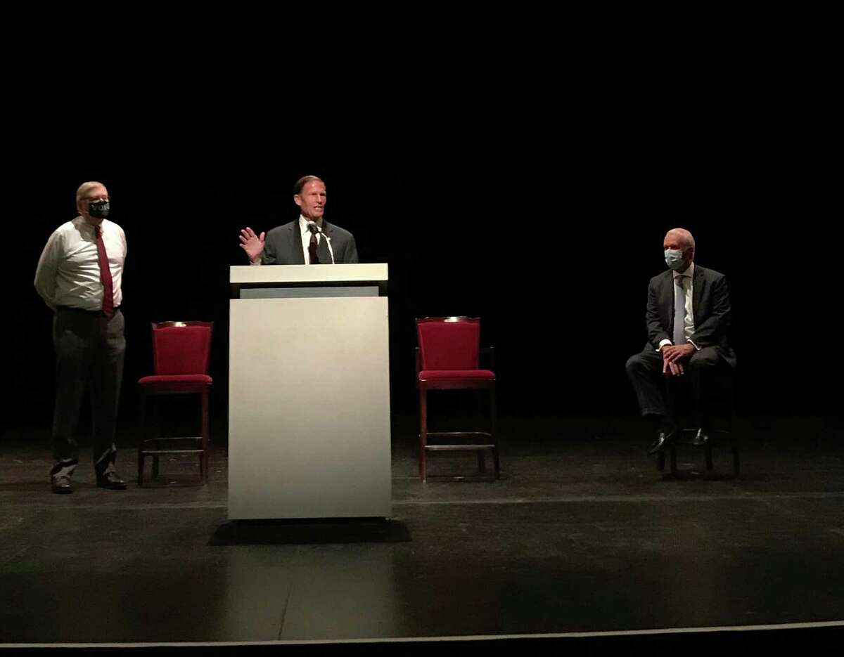 U.S. Sen. Richard Blumenthal, D-Connecticut, makes a point during a meeting Tuesday, Sept. 8, 2020 at The Palace Theatre at 61 Atlantic St., in downtown Stamford, Conn., as Stamford Mayor David Martin, left, and Palace CEO and president Michael Moran Jr. look on.