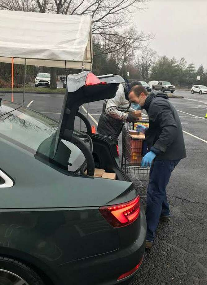 State Rep. Brian Farnen (R-132) unloads donations to the Operation Hope food pantry at a food drive in April. Photo: Alexis Harrison
