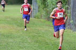 Carlinville freshman Will Meyer (right) approaches the finish with sophomore teammate Brody Harris right behind for the Cavaliers 2-3 finish in their season-opening Carlinville Early Meet on Sept. 1 at Loveless Park in Carlinville.