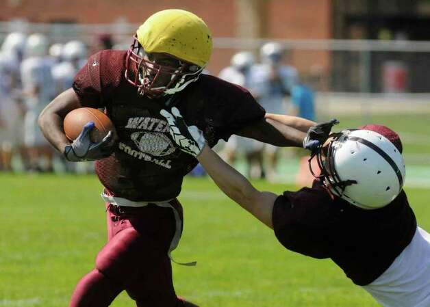 Watervliet running back A'Jon Arrington breaks for a gain during his team's scrimmage against Lansinburgh. ( Michael P. Farrell / Times Union ) Photo: Michael P. Farrell