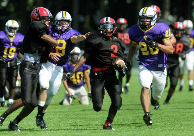 Albany Academy running back Zay Richardson, center, gets good defense on his run to the end zone during their scrimmage against Voorheesville. (Cindy Schultz / Times Union) Photo: Cindy Schultz