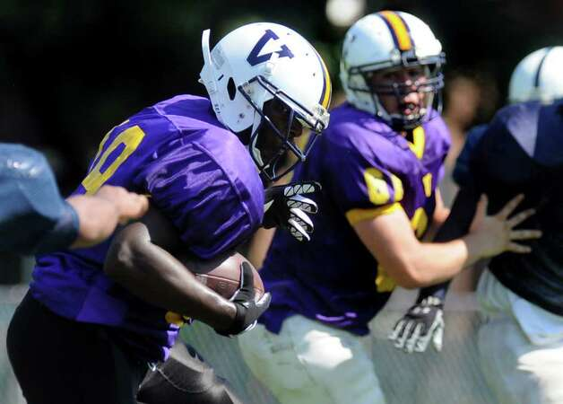 Voorheesville's halfback Aumir Roberson, left, carries the ball during their scrimmage against Rensselaer. (Cindy Schultz / Times Union) Photo: Cindy Schultz