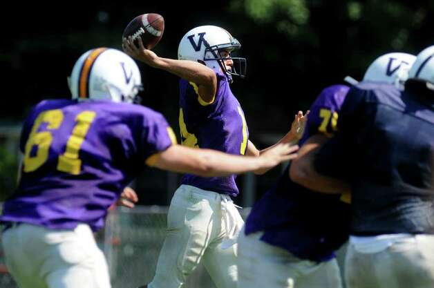 Voorheesville quarterback Ryan Duncan, center, throws a pass during their scrimmage against Rensselaer. (Cindy Schultz / Times Union) Photo: Cindy Schultz