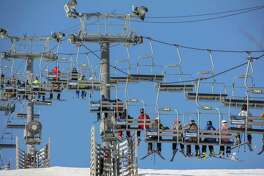 Crystal Mountain is adding radio frequency identification devices to its chairlift system to reduce time spent waiting in lift lines for skiers.