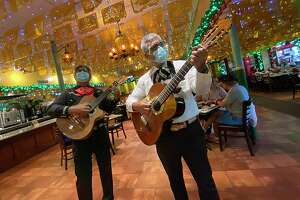 Mariachis are part of the experience when you order pizza from the Zapata's Pizza menu at Mi Tierra Cafe y Panadería.