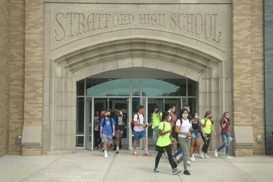 Students leave the recently completed east wing of the new Stratford High School campus following the first day of classes, in Stratford, Conn. Sept. 9, 2020. Photo: Ned Gerard / Hearst Connecticut Media / Connecticut Post