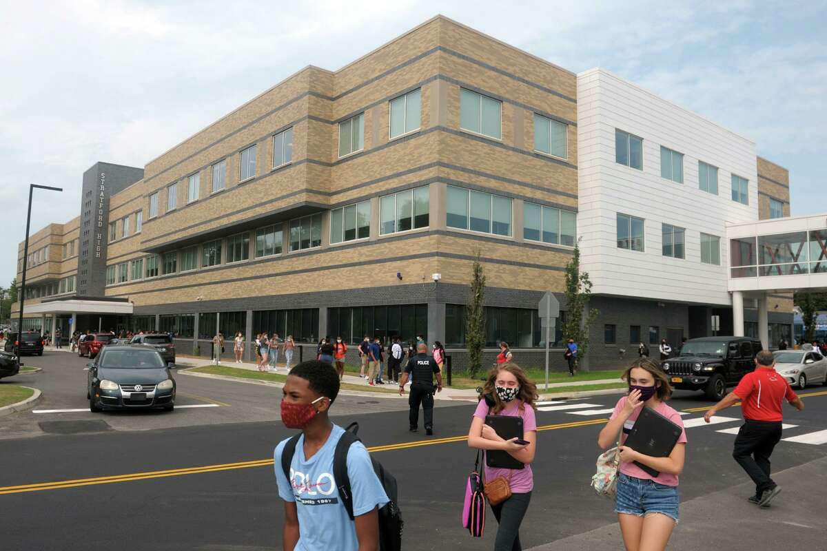 Students leave the main building of the new Stratford High School following the first day of classes, in Stratford, Conn. Sept. 9, 2020.