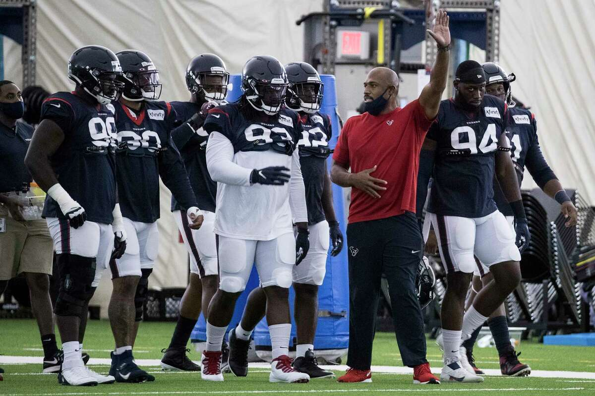 Houston Texans defensive coordinator Anthony Weaver works with the defensive line during NFL football training camp practice Saturday, Aug. 15, 2020 in Houston.