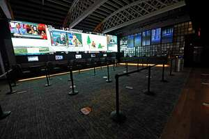 Where tables and chairs once were, social distancing guides are seen on the floor of the sports betting room at Rivers Casino on Wednesday, Sept. 9, 2020 in Schenectady, N.Y. Rivers Casino & Resort Schenectady reopens following a shutdown of state casinos under coronavirus safety guidelines. (Lori Van Buren/Times Union)