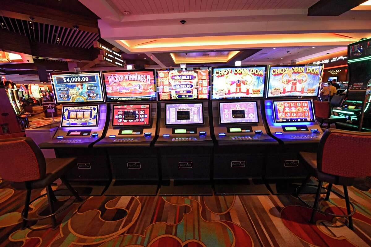 Three middle slot machines display out of service signs to comply with social distancing mandates at Rivers Casino on Wednesday, Sept. 9, 2020 in Schenectady, N.Y. The New York Gaming Commission has no one on its excluded list who would be banned from a casino - which is in contrast to many other gaming states like Pennslyania and New Jersey. (Lori Van Buren/Times Union)