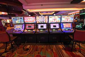 Three middle slot machines display out of service signs to comply with social distancing mandates at Rivers Casino on Wednesday, Sept. 9, 2020 in Schenectady, N.Y. Rivers Casino & Resort Schenectady reopens following a shutdown of state casinos under coronavirus safety guidelines. (Lori Van Buren/Times Union)