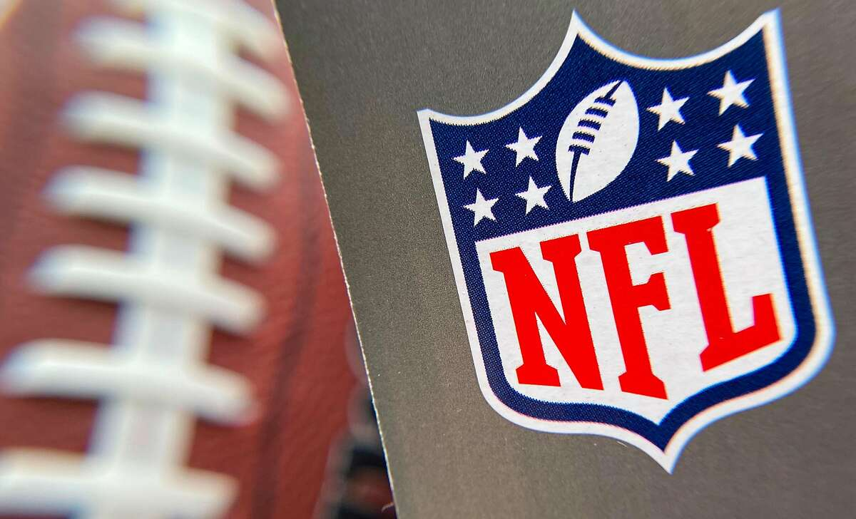 In this file photo taken on August 24, 2020 the NFL logo is seen on a football packaging in Los Angeles. - The NFL kicks off its new season shrouded in trepidation on September 10, 2020 as America's most popular sport grapples with the new realities of life in the age of Covid-19.