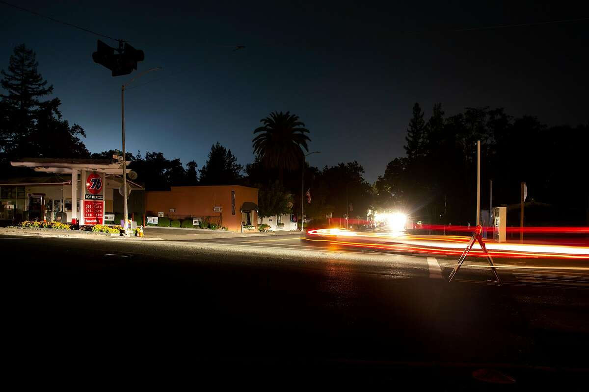 Cars drive through the unlit intersection of Lincoln Avenue and Foothill Boulevard in Calistoga on Tuesday, September 8, 2020. PG&E shut off power to portions of the North Bay following red flag warnings due to high heat and wind conditions throughout the Bay Area.