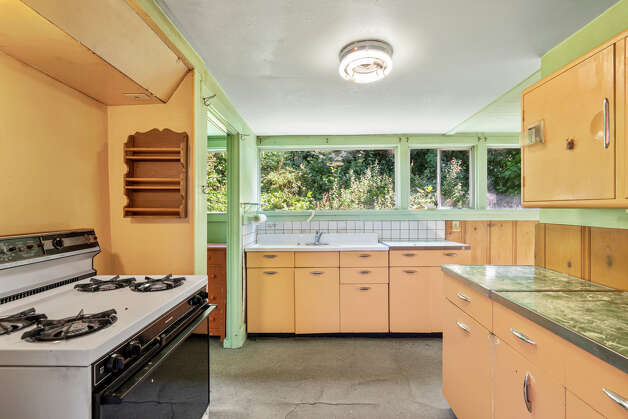 There's a bright, but certainly dated kitchen. Photo: Aerial Canvas