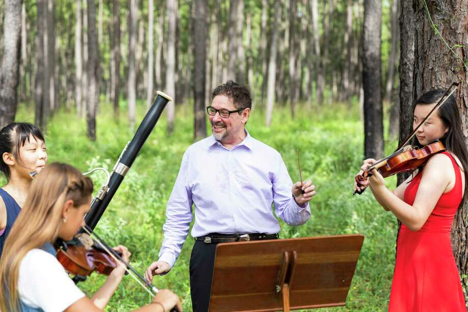 Darryl Bayer, Artistic Director of the Woodlands Symphony, center, expects more outdoor concerts for the Woodlands Symphony in 2020-21. The Woodlands Symphony has undergone a transformation to be able to move forward during COVID-19. Photo: Courtesy Photo / Julie Soefer Photography
