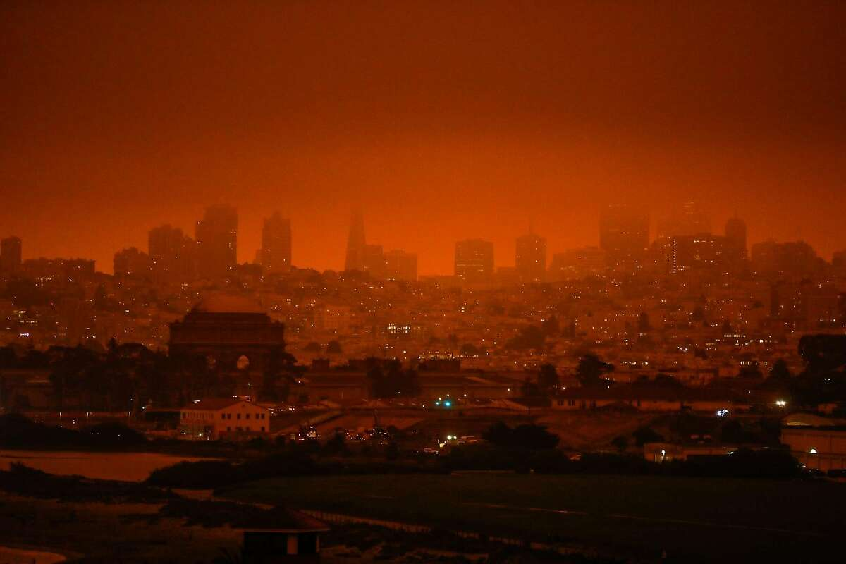 A view of the downtown San Francisco shrouded in dark orange smoke in San Francisco, Calif. Wednesday, September 9, 2020 due to multiple wildfires burning across California and Oregon.