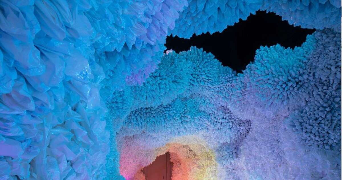 """""""Rainbow Cave,"""" made of salvaged plastic bags and fishing nets by Brooklyn-based artist Basia Goszczynska, is among the installations that will be part of the San Antonio debut of Hopscotch, an interactive art gallery."""