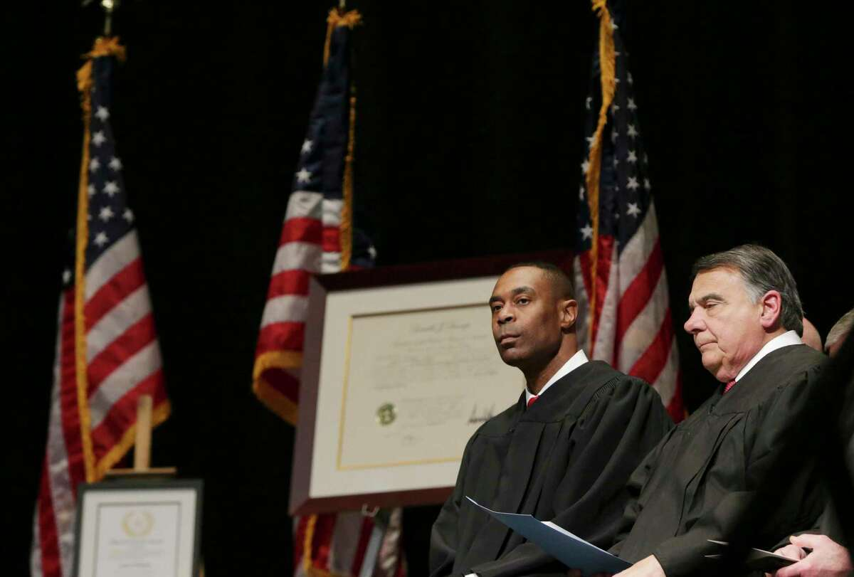 U.S. District Judge Orlando Garcia, right, issued a ruling Tuesday, Sept. 8, 2020, in a mail ballot lawsuit brought by various voting rights groups. At left is Jason K. Pulliam, who was being sworn in as a federal judge by Garcia in February 2020.