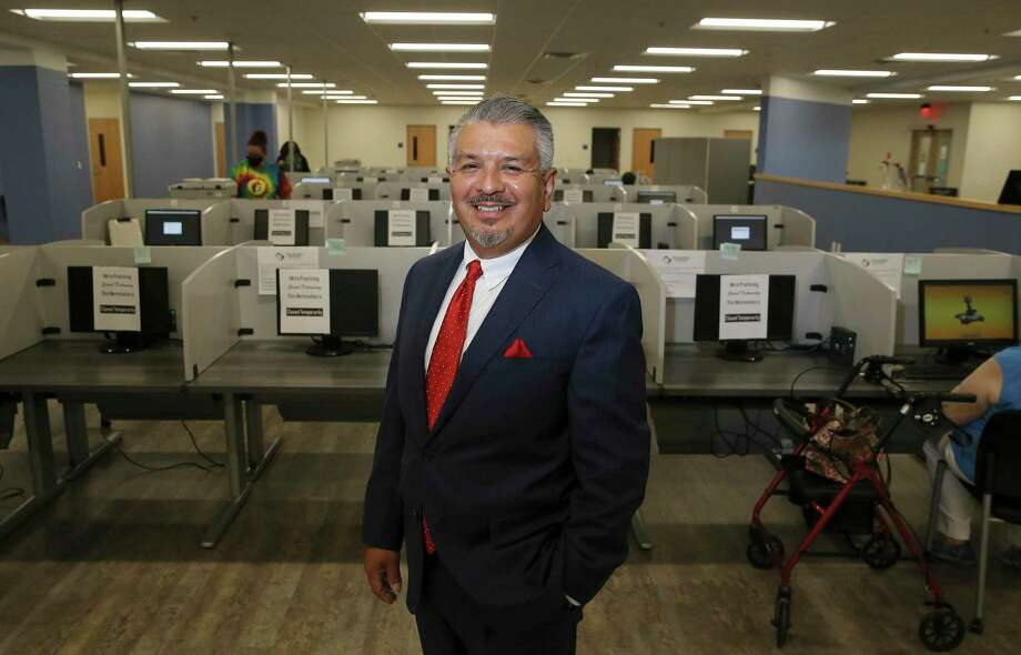 Workforce Solutions Alamo and CEO Adrian Lopez acts as the lead for intake and as a clearinghouse for job applicants. Lopez was at the organization's newest center where, due to the pandemic and safety protocols, are accepting appointments only for job applicants to search for potential work in the area. Photo: Kin Man Hui, San Antonio Express-News / Staff Photographer / **MANDATORY CREDIT FOR PHOTOGRAPHER AND SAN ANTONIO EXPRESS-NEWS/NO SALES/MAGS OUT/ TV OUT