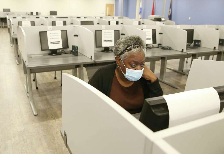 Sandra Campbell looks for job opportunities on a computer at Workforce Solutions Alamo. CEO Adrian Lopez and the organization acts as the lead for intake and as a clearinghouse for job applicants. Lopez was at the organization's newest center where, due to the pandemic and safety protocols, are accepting appointments only for job applicants to search for potential work in the area. Photo: Kin Man Hui, San Antonio Express-News / Staff Photographer / **MANDATORY CREDIT FOR PHOTOGRAPHER AND SAN ANTONIO EXPRESS-NEWS/NO SALES/MAGS OUT/ TV OUT