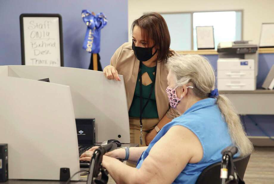 Career Counselor Jessica Donovan meets with a client using a computer station at Workforce Solutions Alamo. The organization and CEO Adrian Lopez act as the lead for intake and as a clearinghouse for job applicants. Lopez was at the organization's newest center where, due to the pandemic and safety protocols, are accepting appointments only for job applicants to search for potential work in the area. Photo: Kin Man Hui, San Antonio Express-News / Staff Photographer / **MANDATORY CREDIT FOR PHOTOGRAPHER AND SAN ANTONIO EXPRESS-NEWS/NO SALES/MAGS OUT/ TV OUT
