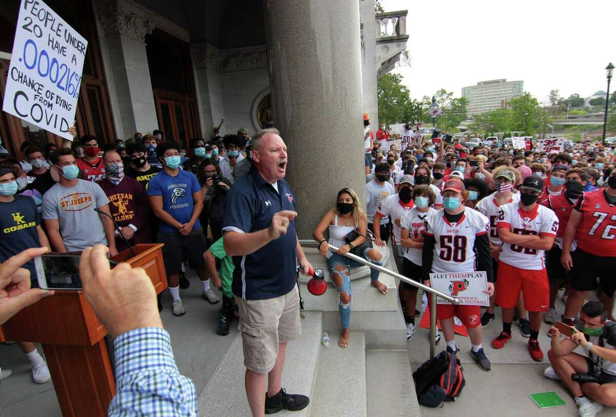 New Fairfield's Mike Peterson speaks during a rally held on the grounds of the State Capitol building in Hartford in September. High school football coaches and players from across the state came to Hartford to protest not being able to play in the upcoming season due to the coronavirus.