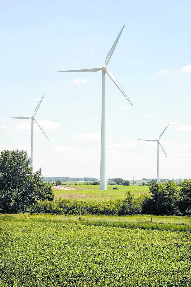 Power-generating windmills tower over a farm near Steward. Apex Clean Energy has moved a step closer to bringing up to 107 wind turbines to Morgan County. Photo: Scott Olson / 2006 Getty Images