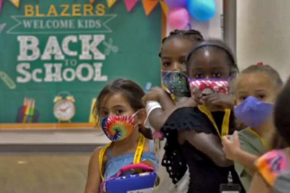 A group of Lamar CISD students wearing face coverings are shown in a back-to-school video posted to the district website on Sept. 8. Lamar, which resumed in-person classes on Aug. 24 with about 21,700 people on campuses, is reporting 12 active cases of COVID-19 among students who spent time on school grounds and seven active cases among staff members.
