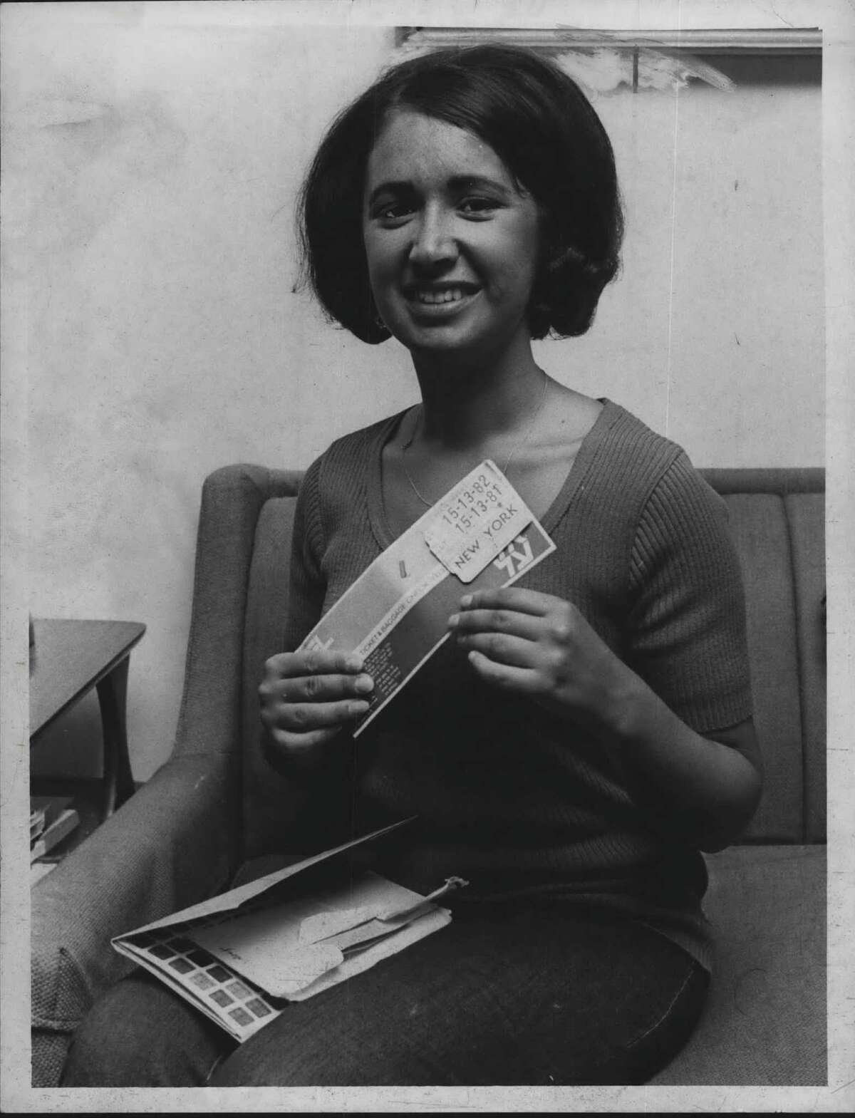Isabel Berkowitz shows off airline ticket in New York. September 1970 (Joe Higgins/Times Union Archive)