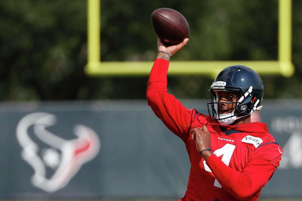 FILE - Houston Texans quarterback Deshaun Watson throws a pass during an NFL training camp football practice Friday, Aug. 21, 2020, in Houston. It has been a mere eight months since Patrick Mahomes led Kansas City from a 24-0 hole to beat Deshaun Watson and the Houston Texans in the divisional round of the playoffs, a brutally efficient comeback that ultimately propelled the Chiefs to their first Super Bowl title in 50 years. A whole lot has changed, though.(Brett Coomer, Houston Chronicle via AP, Pool, File)