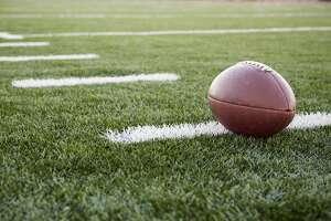 Football in field