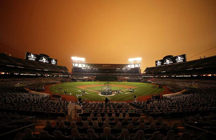 PHOTOS: More of the eerie orange sky at the Astros-A's baseball game