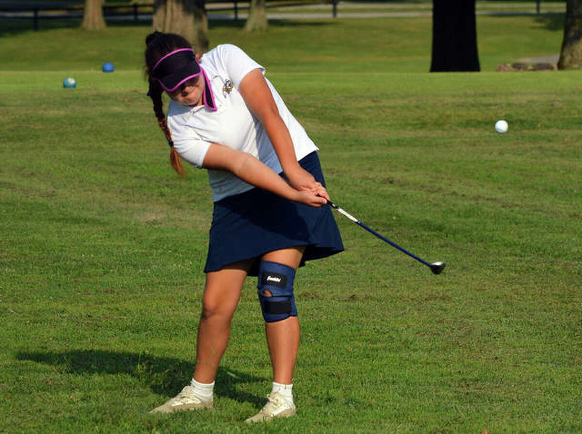 Father McGivney's Paige Yasitis hits a chip shot on hole No. 4 at Belk Park Golf Course during a quadrangular match against Marquette, Civic Memorial and Roxana on Wednesday.