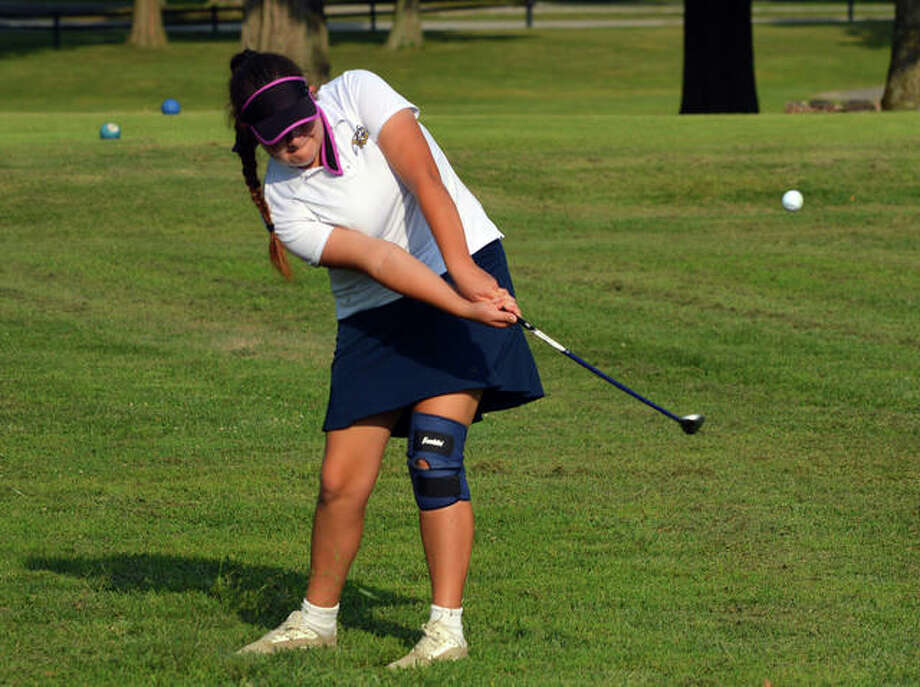 Father McGivney's Paige Yasitis hits a chip shot on hole No. 4 at Belk Park Golf Course during a quadrangular match against Marquette, Civic Memorial and Roxana on Wednesday. Photo: Scott Marion/The Intelligencer
