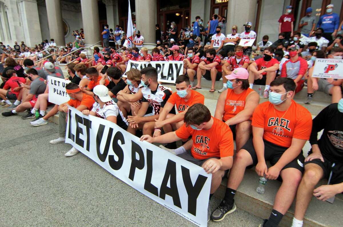 High school football coaches, players and their families from across the state came to the Hartford State Capitol building to protest not being able to play in the upcoming season due to the coronavirus on Wednesday.