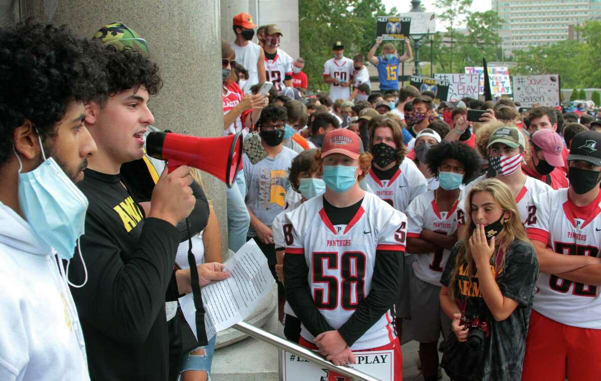 Amity High football player Cameron Luciano speaks during a rally held on the grounds of the State Capitol building in Hartford on Wednesday. High school football coaches and players from across the state came to Hartford to protest not being able to play in the upcoming season due to the coronavirus.