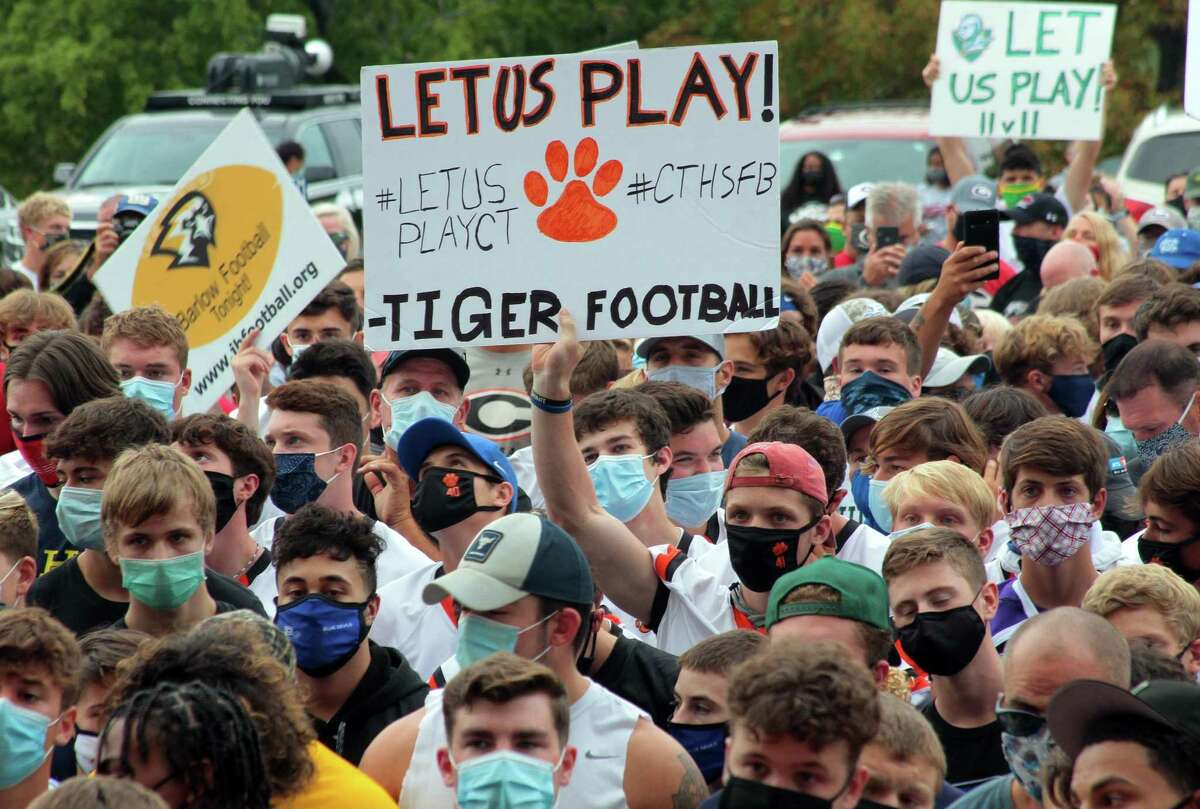 High school football coaches, players and their families from across the state came to the Hartford State Capitol building to protest not being able to play in the upcoming season due to the coronavirus in Hartford, Conn., on Wednesday Sept. 9, 2020.