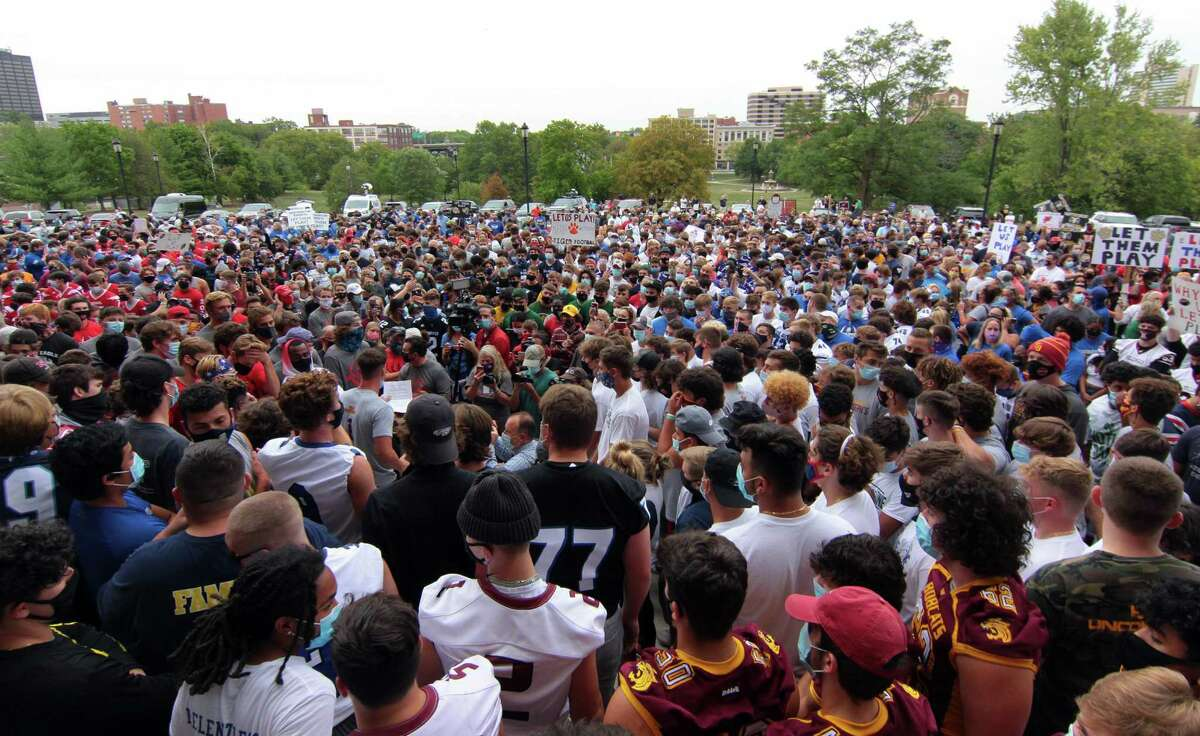 Over a thousand high football coaches, players and their families attend a rally held on the grounds of the State Capitol building in Hartford, Conn., on Wednesday Sept. 9, 2020. They came to Hartford to protest not being able to play in the upcoming season due to the coronavirus.