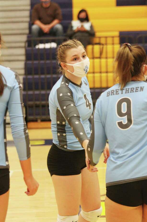Executive Order 2020-180 specifies that a face covering must be worn at all times by athletes training for, practicing for, or competing in an organized sport when the athlete cannot maintain 6 feet of social distance, except for occasional and fleeting moments. Brethren volleyball players are shown here wearing masks Wednesday night during competition at Manistee High School. (Dylan Savela/News Advocate)