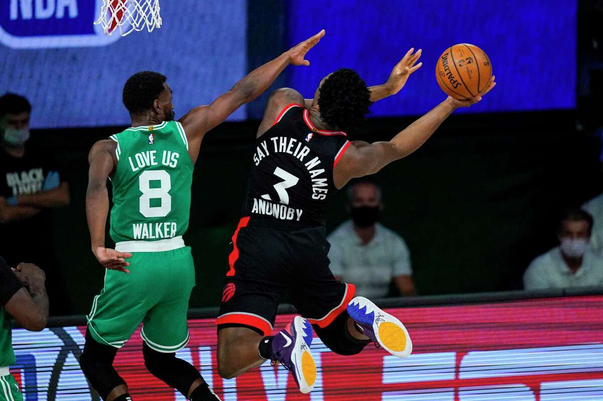 Toronto Raptors forward OG Anunoby (3) looks to shoot over Boston Celtics guard Kemba Walker (8) during the second half of an NBA conference semifinal playoff basketball game Wednesday, Sept. 9, 2020, in Lake Buena Vista, Fla. (AP Photo/Mark J. Terrill)