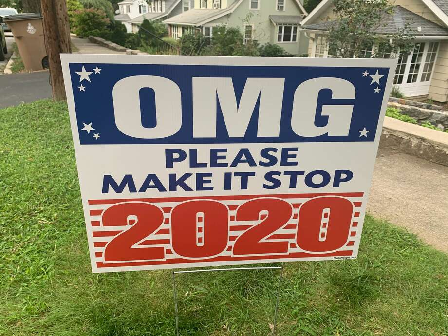 A sign reads 'OMG Please Make it Stop 2020' in front of a House in Stamford. Photo: Mandy Hofmockel/Hearst CT Media