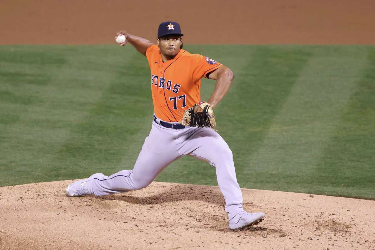 OAKLAND, CALIFORNIA - SEPTEMBER 09: Luis Garcia #77 of the Houston Astros pitches against the Oakland Athletics in the second inning at RingCentral Coliseum on September 09, 2020 in Oakland, California.
