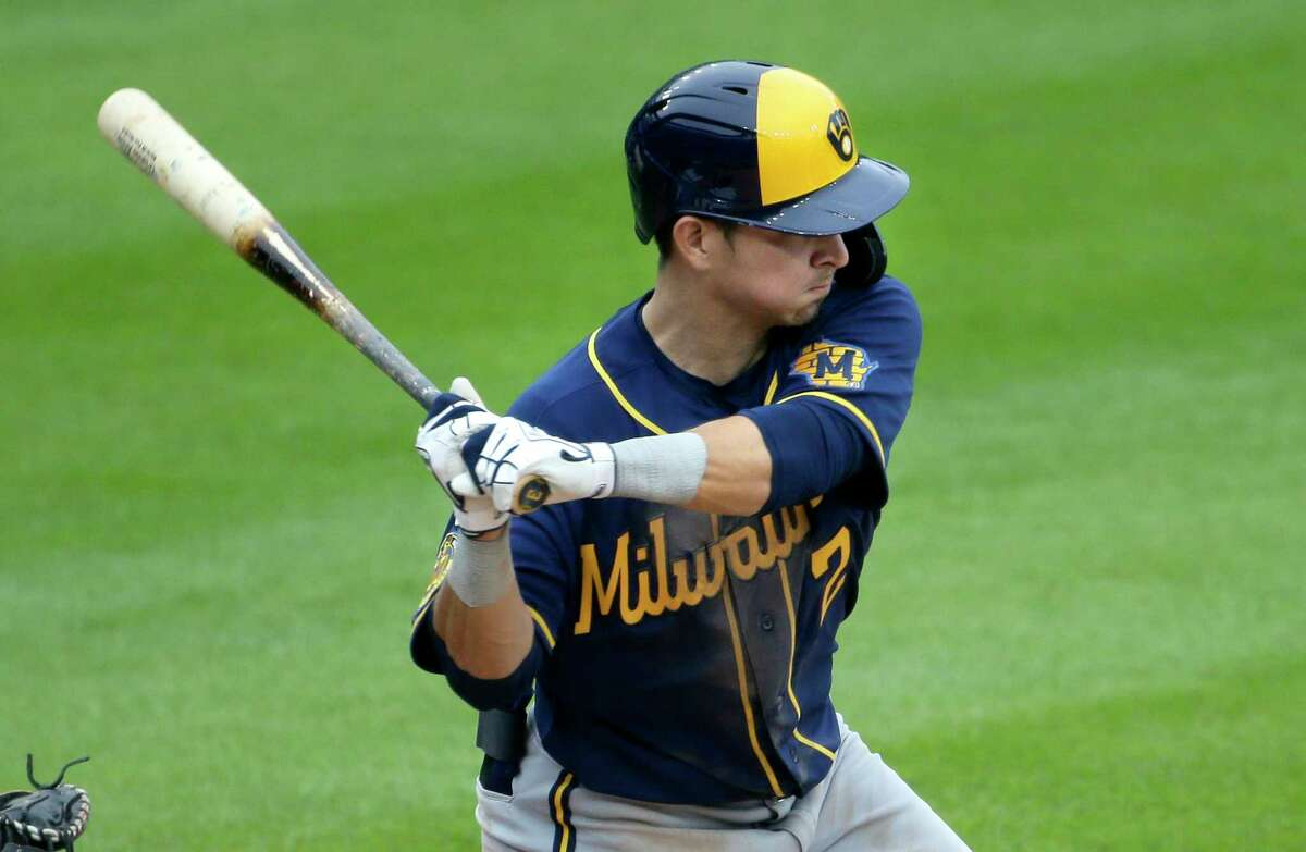 Milwaukee Brewers' Luis Urias (2) hits a double to drive in Christian Yelich and Ryan Braun during the sixth inning of a baseball game against the Detroit Tigers Wednesday, Sept. 9, 2020, in Detroit. The Brewers defeated the Tigers 19-0. (AP Photo/Duane Burleson)