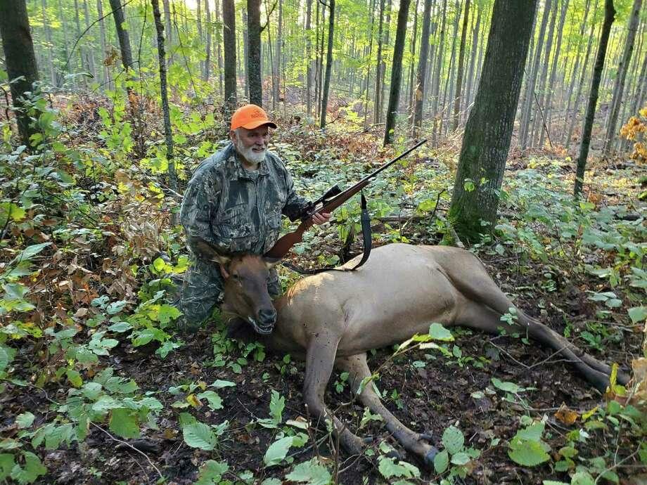 Lou Leavens of Sterling Heightsshowsthe hard-earned cow elk he shot nearAtlanta during the Michigan early elk season last week. (Photo by Jake Lounsbury)