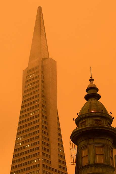 The Transamerica Pyramid and Sentinel Building look orange as smoke from wildfires in California and Oregon spread over San Francisco on Sept. 9, 2020 darkening the skies to an orange hue. Photo: Douglas Zimmerman/SFGATE / SFGATE