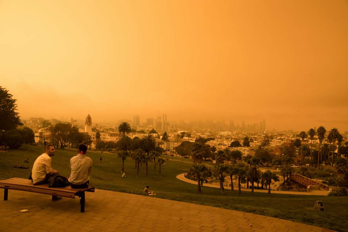The view of downtown San Francisco from Dolores Park. Smoke from wildfires in California and Oregon spread over San Francisco on Sept. 9, 2020 darkening the skies to an orange hue.