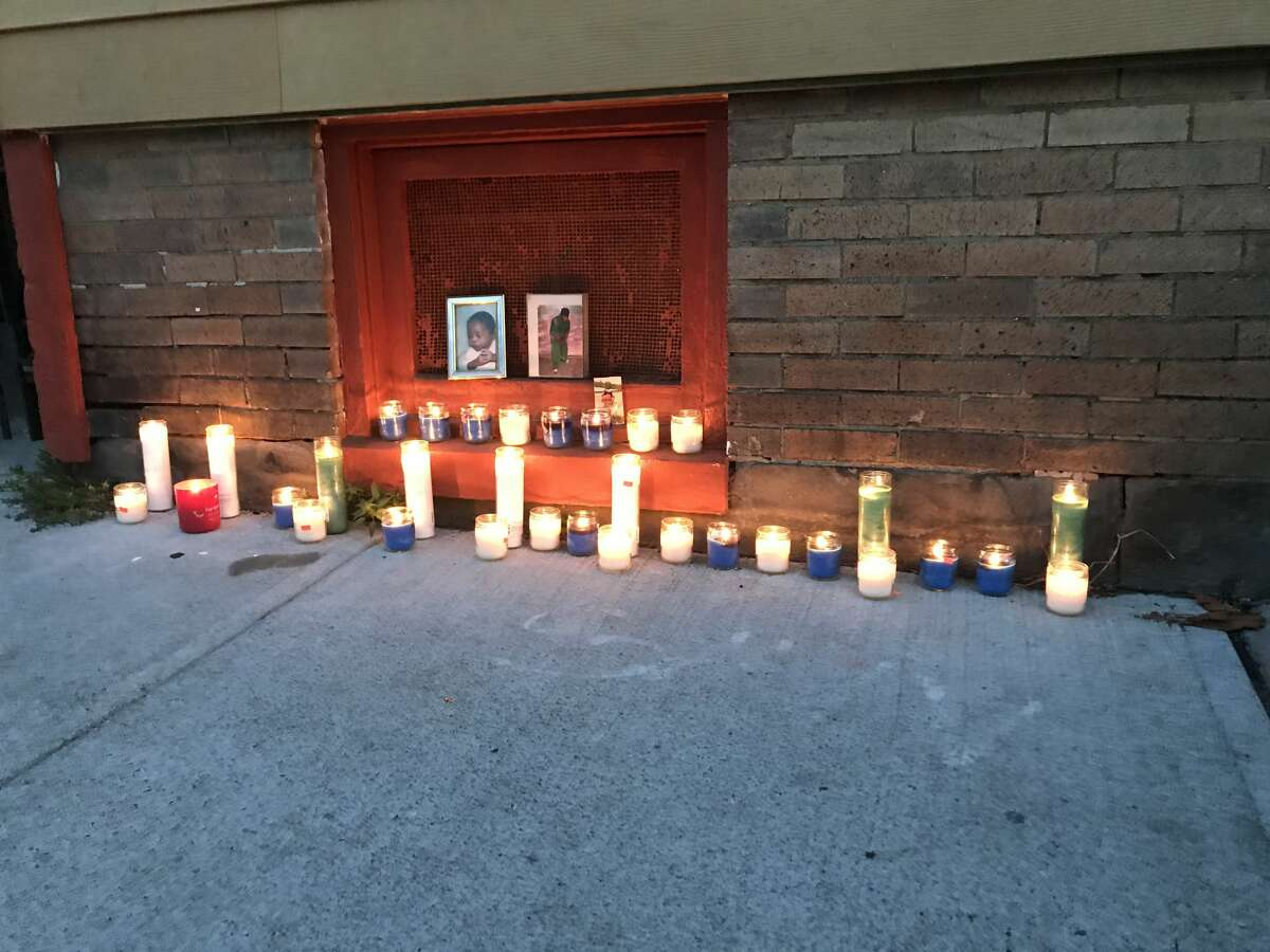 A memorial for a shooting victim was quickly assembled near where a 39-year-old man was shot and killed early Thursday on First Street. The killing, which occurred on the block between Quail and Ontario streets, is Albany's 14th homicide of the year.